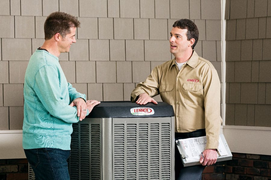 Robinson Heating & Cooling Outdoor Dealer with Customer